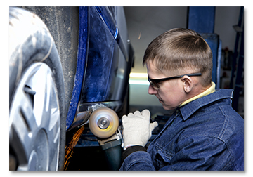 Auto Mechanic Repairing Car Frame