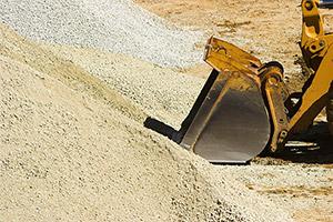 Bulldozer Scooping Sand