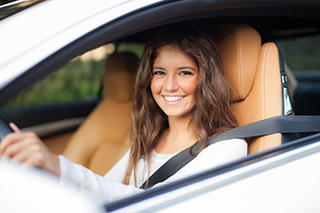Woman In New Preowned Car