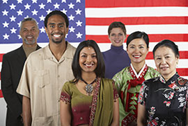Immigrants In Front Of American Flag