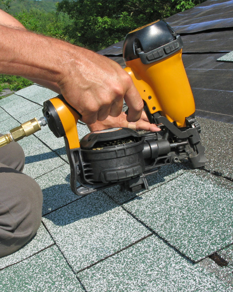 Roofer Installing Roof Shingles
