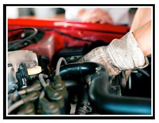 Mechanic Repairing Under Auto Hood