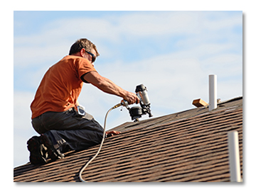 Roofer Repairing Shingle Roof